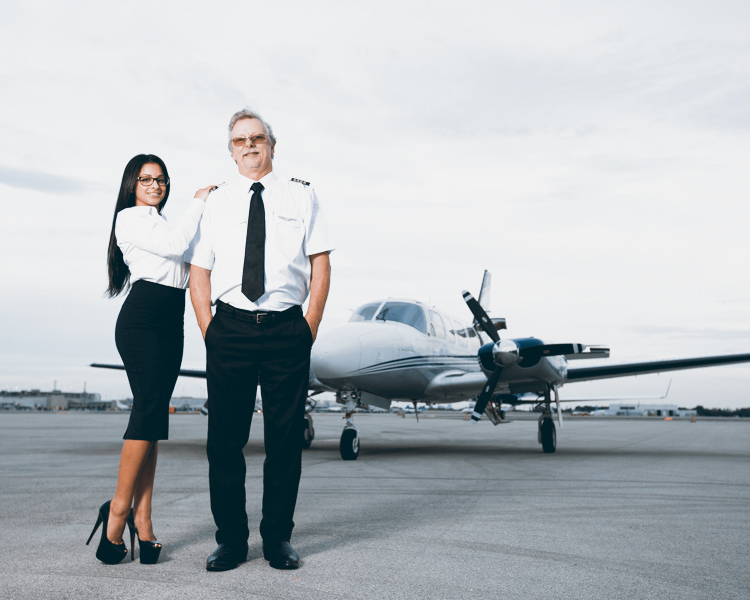 a pilot and a flight attendant in front of a turboprop