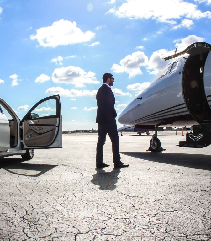 a businessman going toward private jet