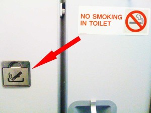 Why are there ash trays in the toilets of airplanes if it`s forbidden to smoke?
